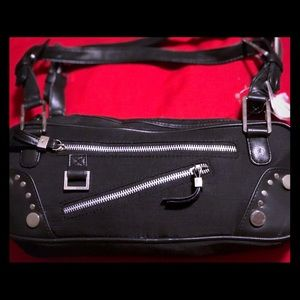 Black bag with silver zippers